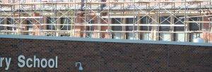 picture of school with scaffolding set up on far wall