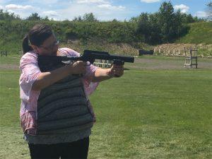 Renee Van Nett firing a launcher