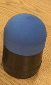 A projectile with black plastic base and blue hard foam tip