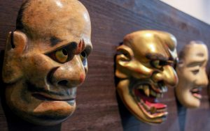 Picture of three masks used for theatre showing different emotions